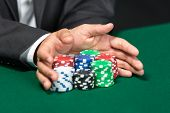 stock photo of poker hand  - Poker player going  - JPG