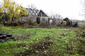 stock photo of house woods  - abandoned barn and house at the Ukraininan village - JPG