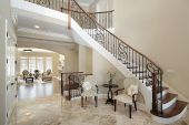 picture of entryway  - Foyer in new construction home with curved staircase  - JPG