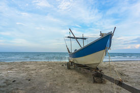 pic of carron  - Traditional Fisherman Wooden Boat with blue skies - JPG