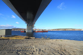 pic of flatboat  - bridge construction reaching over water view from beneath - JPG