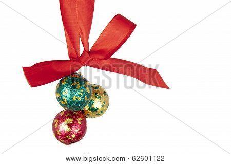 Christmas Balls Hanging On Celebratory Ribbon
