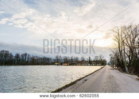 Road Running Along Flooded Field
