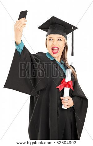 Female college graduate holding a diploma and taking selfie isolated on white background