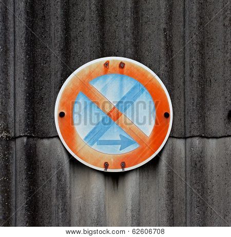 Traffic Sign On A Asbestos Wall