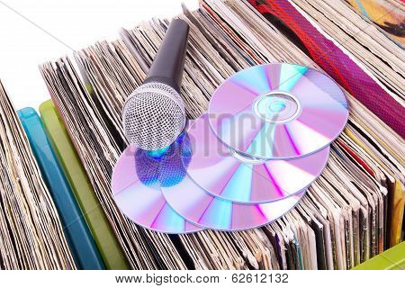 Microphone And Compact Disks On Records