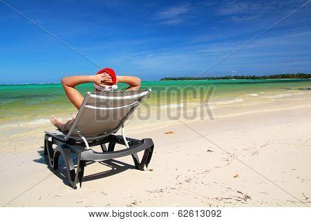 Santa On Chaise Longue On Tropical Beach