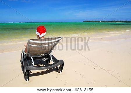 Santa On Chaise Longue On Beach