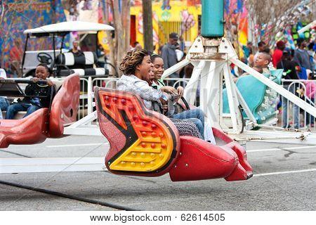 Women Laugh Riding Scrambler Carnival Ride