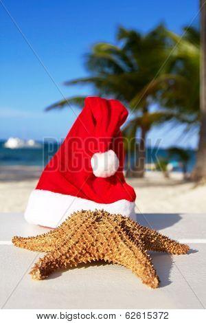 Santa Hat And Starfish On Beach