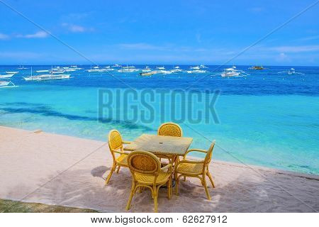 Table And Chairs On Tropical Beach