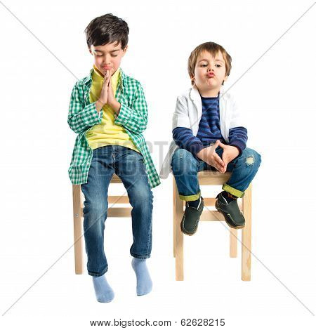 Blonde Boys Pleading Over Isolated White Background