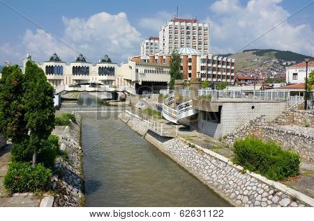 NOVI PAZAR, SERBIA - 26 July: the modern city center of Novi Pazar with the architectural complex of the hotel Vrbak on the Raska river. Shot in 26 July, 2013.