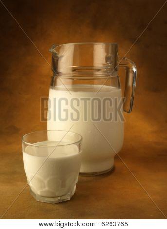 Milk jug and glass