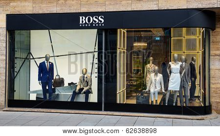 STUTTGART, GERMANY - APRIL 01, 2014: Hugo Boss store. Hugo Boss based in Metzingen in Germany it has 12,000 staff, 840 own stores and 2012 sales of EUR 2.3 billion in 129 countries.
