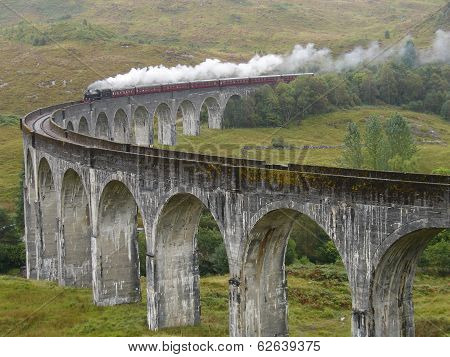 Steam train on Glenfinnan viaduct.