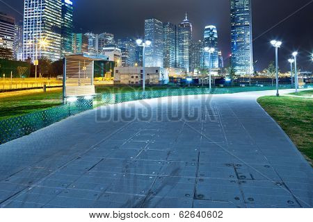 pathway in the night with modern city background