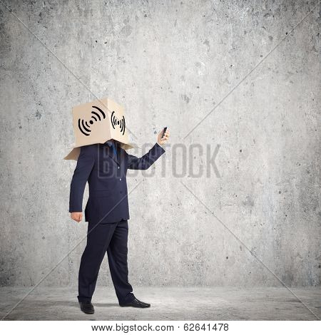 Troubled businessman with carton box on head expressing emotions
