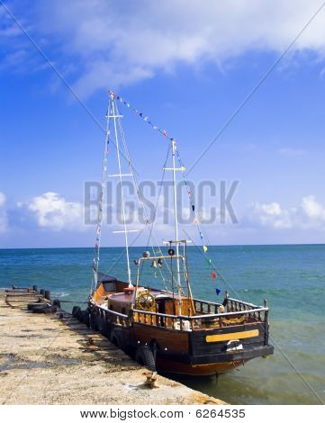 Wooden Retro Boat In A Sea