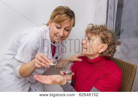 Doctor Giving Pills