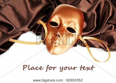 Mask on brown fabric on white background