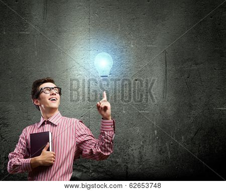 Young man in casual with book in hands
