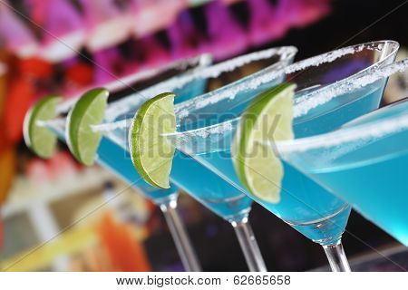 Blue Curacao Cocktails In Martini Glasses In A Bar