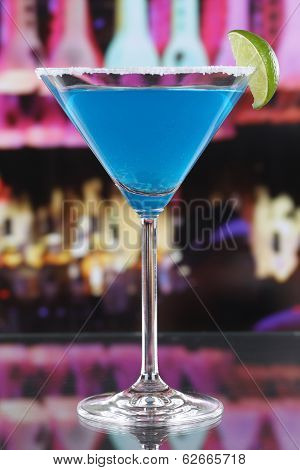 Blue Curacao Cocktail In Martini Glass In A Bar