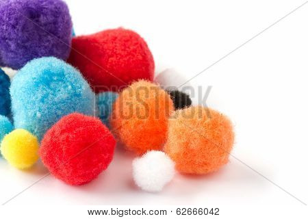 Colorful fluffy pom poms