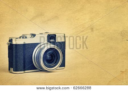 Vintage rangefinder style camera on a textured background  with space for text