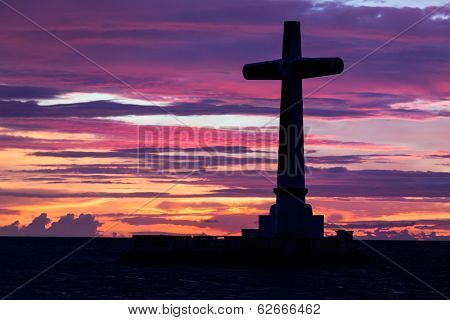 Catholic cross silhouette in the sunken cemetery at dusk, Camiguin island, Philippines