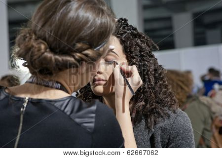 ZAGREB, CROATIA - MARCH 28, 2014: Fashion model prepares in backstage for Couture show by Marina Design on 'Fashion.hr' fashion show