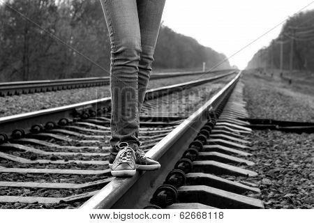 Girl Walking Across Railroad. B&w Image