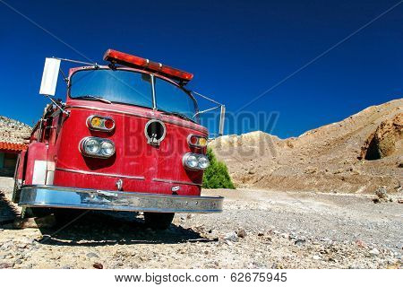 DEATH VALLEY, USA - 11 MAY, 2007: Old fire truck located in the desert in Death valley. Situated within Mojave Desert, it is lowest and driest area in North America, and currently hottest in the world