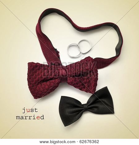 a pair of bow ties, one of them forming a heart, wedding rings and the sentence just married on a beige background, with a retro effect