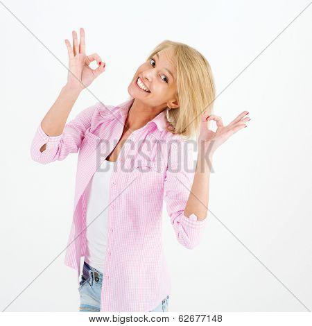 picture of lovely woman showing ok sign