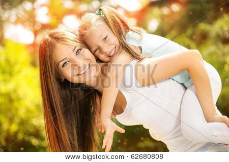 Mother And Daughter In The Nature
