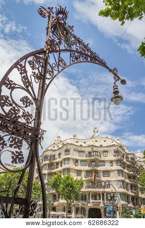 Modernist lamppost with Casa Mila in background