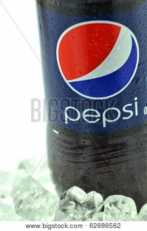 Bottle of Pepsi drink on ice isolated on white