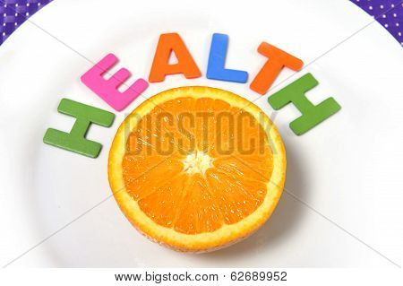 half Fresh And Healthy Orange Fruit Stillife And Health Word On Plate