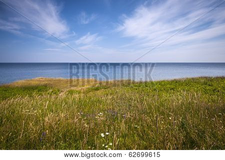 View of Atlantic ocean from cliff edge in Prince Edward Island, Canada.