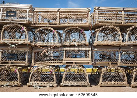 Stacks of wooden lobster traps on pier in North Rustico, Prince Edward Island, Canada.