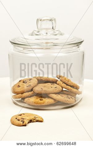 Glass cookie jar with chocolate chip cookies