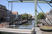 pic of historical ship  - The Historic Delfshaven downtown Rotterdam with old ships and a drawbridge - JPG