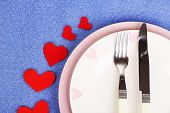 Valentines day dinner with table setting on blue background