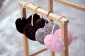 stock photo of gey  - Pretty pink, gey and black fluffy ear mufs