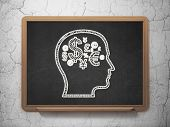 Education concept: Head With Finance Symbol on chalkboard