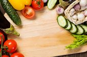 Close up of various vegetables on wooden cutting board