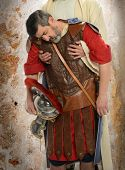 Jesus hands holding exhausted Roman soldier