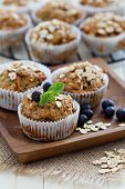 stock photo of oats  - Vegan banana carrot muffins with oats and berries - JPG